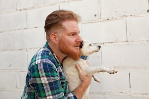 Red haired man with his dog