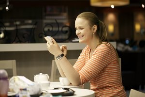 Young woman chatting smartphone