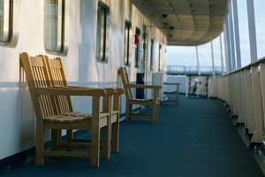 Wooden chairs deck of cruise liner