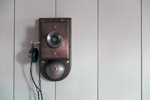 Old phone on a wooden wall