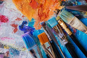 Paint brushes on painted background