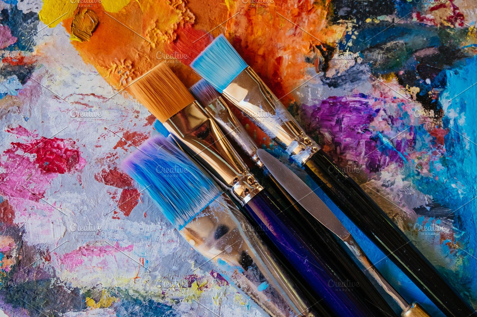 Paint brushes on painted background | High-Quality Arts ...
