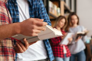 Close up portrait of a group of students holding books