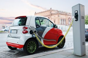 Electro car is charging street.