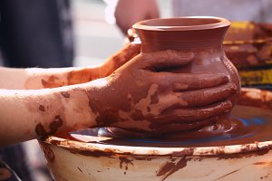 Potter making pot traditional style