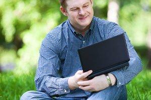 Businessman working in park