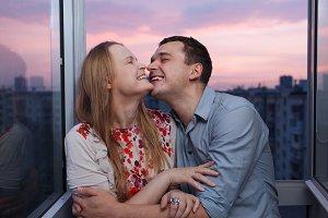 Young couple balcony embracing