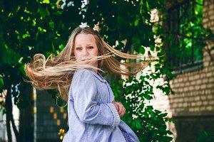 Hair in motion. Little girl spinning. blue eyes