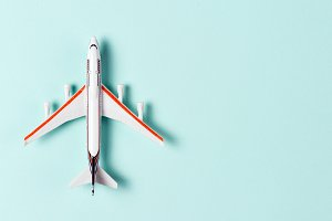 Toy plane on light blue background