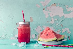 Watermelon juice in glasses with slices of watermelon