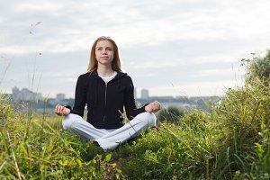 Young girl makes yoga exercises