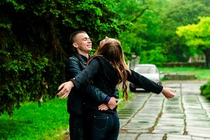 Lovers turn during the rain. Summer warm rain