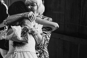 Old lady hug tiny bride tightly