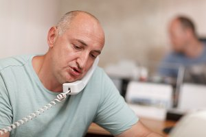 Businessman talking on phone office