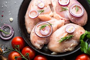 Raw chicken fillet and ingredients.