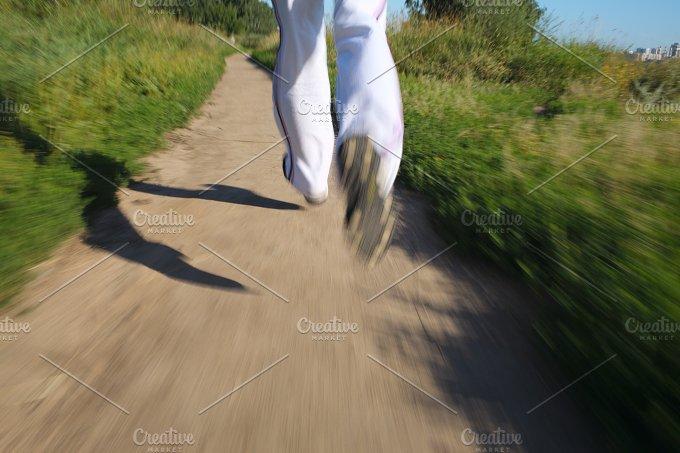 Running park. Detail of legs - People