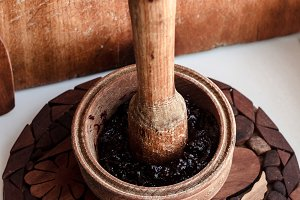 Wooden mortar and a plate