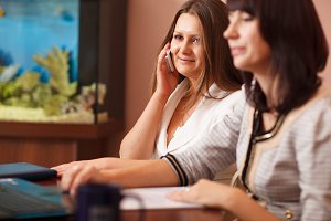 Woman talking on her mobile meeting