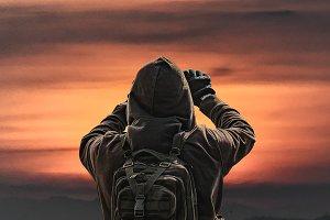 Back View Man Taking Photos of Sunset