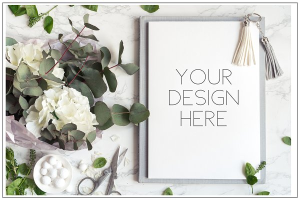 Notepad mockup with flowers.