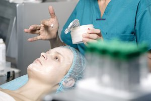 Woman being prepped skincare clinic