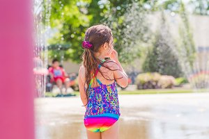 Girl Standing at Splash Park