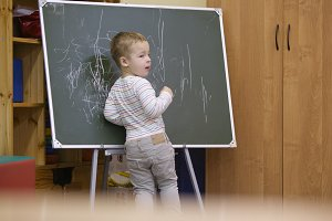 Creative kid drawing chalkboard