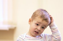 Cute kid with puzzled expression