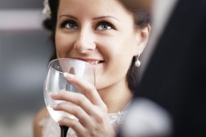 Elegant woman drinking wine function