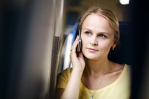 Woman listening call on her mobile