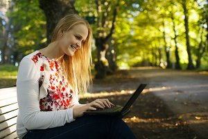 Young woman using her laptop in the