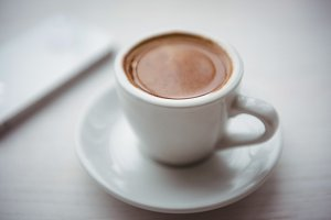 Close-up of a coffee cup on the table