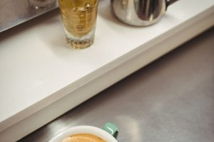 Cup of coffee with beautiful latte art on steel table