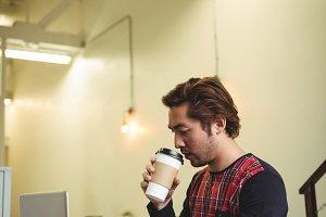 Man using laptop while having coffee