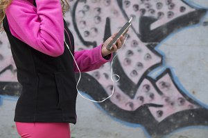 female athlete with cellphone