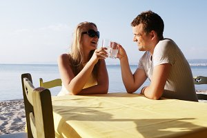Young couple enjoying drinks at the