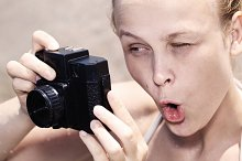Woman photographer pulling a comical