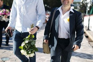 Two smiling men walking down