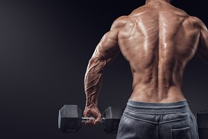 Male bodybuilder with dumbbells