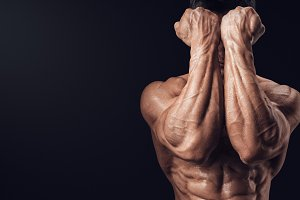Male bodybuilder wiht power hands