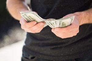 Man holding in hands dollar