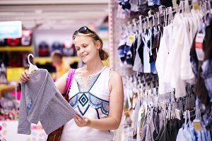 Mother shopping for childrens