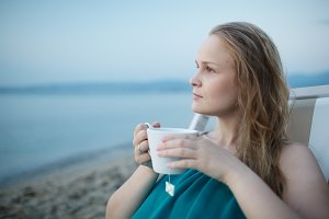 Woman enjoying a cup of tea at the