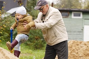 Grandpa helps grandson to get
