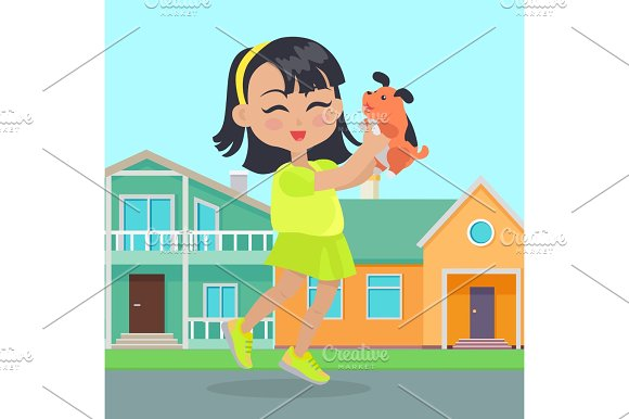 Girl Holds Small Dog In Hands In Front Of Houses