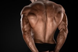 Male bodybuilder showing his back