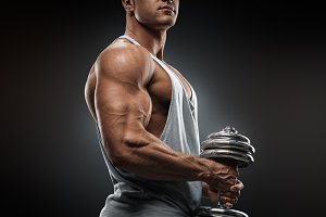 Male bodybuilder with dumbbell