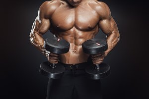Male bodybuilder with dumbbells