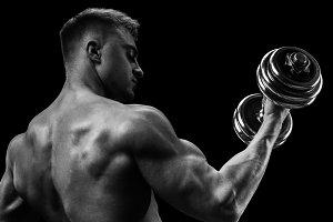 Male bodybuilder doing exercises