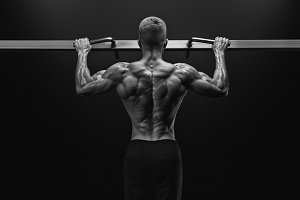 Perfect physique sportsman in gym